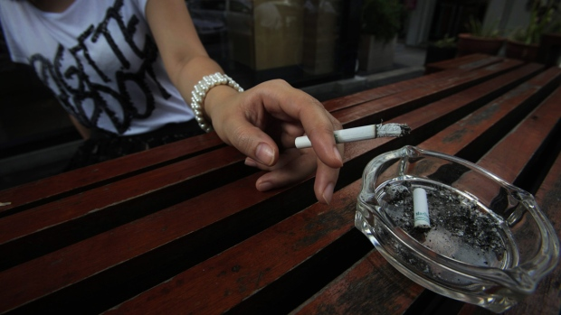 Thai office worker smokes a cigarette