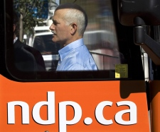 NDP Leader Jack Layton heads from his bus as he visits campaign headquarters in the Westmount-Ville-Marie riding in Montreal on Thursday, Sept. 11, 2008. (Andrew Vaughan / THE CANADIAN PRESS)