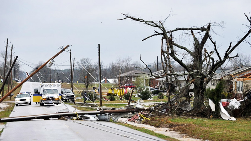Downed power lines and debris caused by a reported tornado lie along Yarbrough Road, Friday, March 2, 2012, in Harvest, Ala. (AP / The Huntsville Times, Bob Gathany)