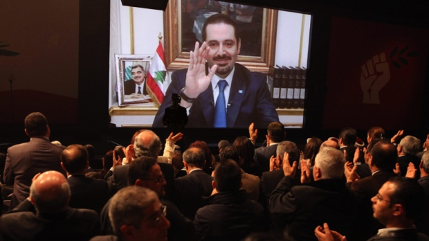 Former Lebanese Prime Minister Saad Hariri speaks via a video link from Paris, during a ceremony to mark the seventh anniversary of the assassination of his father, former Prime Minister Rafik Hariri, in Beirut, Lebanon, Tuesday, Feb. 14, 2012. (AP / Bilal Hussein)