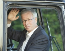 Liberal Leader Stephane Dion waves to supporters as he leaves a breakfast campaign stop in Saint John, N.B., Thursday, Sept. 11, 2008. (Adrian Wyld / THE CANADIAN PRESS)
