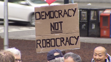 Protesters took to the streets of downtown Vancouver to show their opposition to the �robocalls� scandal. Mar. 3, 2012. (CTV)