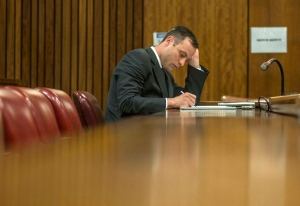 Oscar Pistorius waits for the start of the third day of his sentencing hearing at the high court in Pretoria, South Africa, Wednesday, Oct. 15, 2014. (AP / Ihsaan Haffejee)