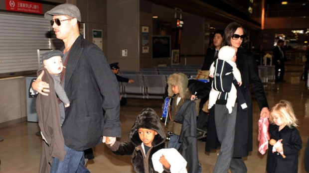 U.S. actor Brad Pitt and actress Angelina Jolie with children arrive at Narita International Airport in Narita, east of Tokyo, Japan, Tuesday, Jan. 27, 2009.