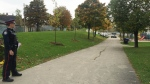A police officer guards a section of a Toronto park and community centre following a woman's death on Oct. 14, 2014. (Janice Golding / CTV Toronto)