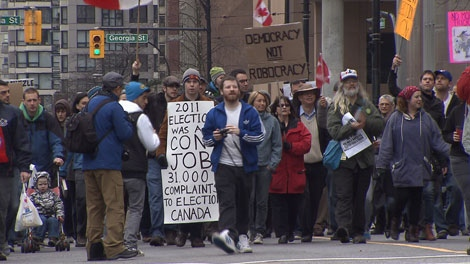 "Hundreds of protesters took to the streets of downtown Vancouver to show their opposition to the ""robocalls"" scandal. Mar. 3, 2012. (CTV)"