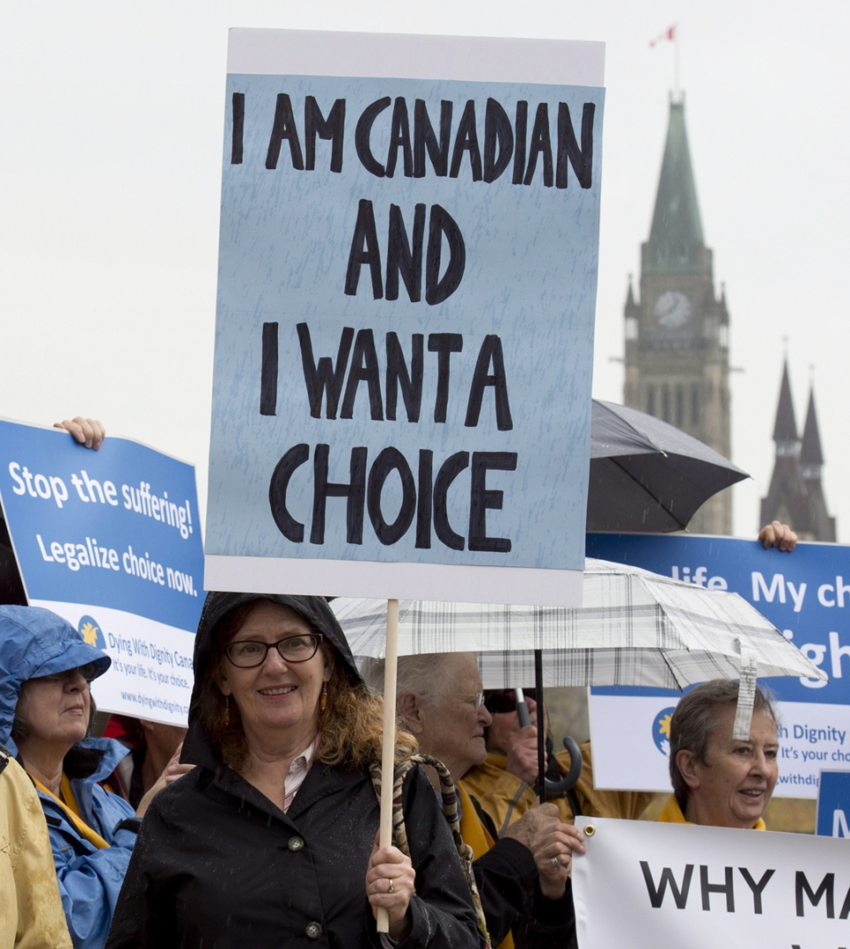 Supporters rally outside the Supreme Court of Canada on the first day of hearings into whether Canadians have the right to seek help to end their own lives, in Ottawa, Wednesday, Oct. 15, 2014. (Adrian Wyld / THE CANADIAN PRESS)