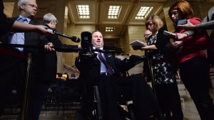 Conservative MP Steven Fletcher, who has drafted private member's bills related to assisted suicide, scrums with reporters in the foyer of the Supreme Court of Canada in Ottawa on Wednesday, Oct. 15, 2014. (Sean Kilpatrick / THE CANADIAN PRESS)