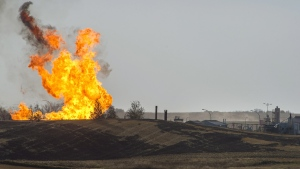 Remaining gas is burned off after explosion and fire at a gas pumping station owned by TransGas near Prud'homme, Sask., Saturday, Oct. 11, 2014. (Liam Richards / THE CANADIAN PRESS)