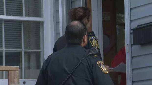 Officers go door to door in Transcona