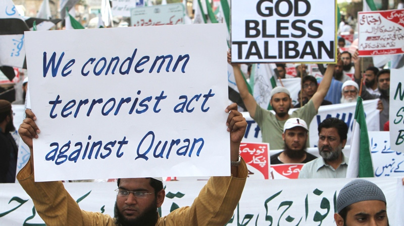Supporters of a Pakistani religious group Tanzeem-e-Islami hold a rally to condemn the disposal last week of a number of Qurans at a U.S. military base in Afghanistan, in Karachi, Pakistan, Saturday, March 3, 2012. (AP / Fareed Khan)