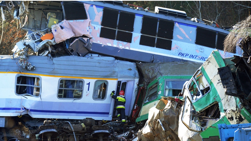 A rescue worker tries to enter a wagon at the train crash site in Szczekociny, Poland, Sunday, March 4, 2012.