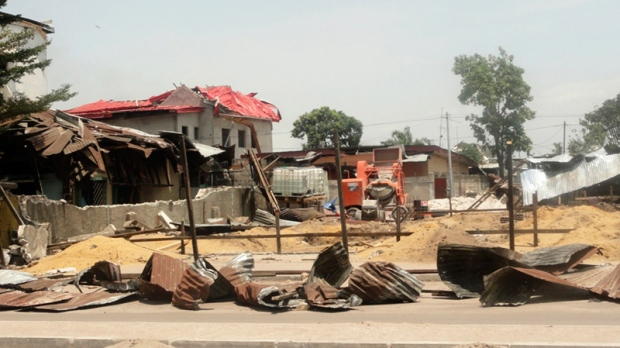 Debris from blast-damaged homes are seen in the Ouenze neighborhood after multiple explosions occurred at a munitions depot, in Brazzaville, Republic of Congo Sunday, March 4, 2012.