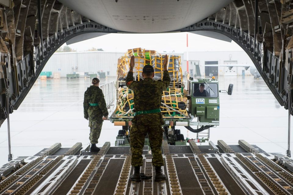 A CC-177 Globemaster aircraft is loaded with vital supplies for Operation IMPACT at 8 Wing Canadian Forces Base Trenton on Oct. 15, 2014. (Cpl. Rod Doucet, 8 Wing Imaging / Department of National Defence)