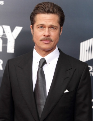 Actor Brad Pitt arrives for the world premiere of 'Fury' at the Newseum on Wednesday, Oct. 15, 2014, in Washington. (Photo by Owen Sweeney/Invision/AP)