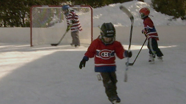 Children play hockey on the Von Eschen family's backyard rink at the home in Montreal in this undated photo.