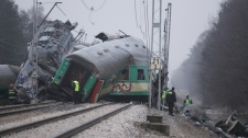 Rescuers work at the site where two trains collided in Szczekociny, southern Poland, Sunday, March 4, 2012. (AP Photo/Michal Legierski)
