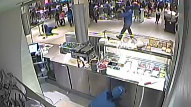 Surveillance video shows Christopher Husbands pointing a gun at the Toronto Eaton Centre on June 2, 2012.
