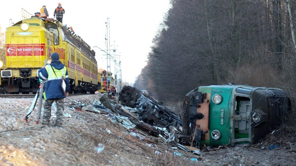 Workers remove debris from the rails, after the Saturday deadly train crash in Szczekociny, Poland, Monday, March 5, 2012. (AP / Wojtek Barczynski)