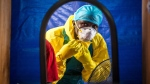 A healthcare worker dons protective gear before entering into an Ebola treatment centre in the west of Freetown, Sierra Leone, Thursday, Oct. 16, 2014. (AP / Michael Duff)
