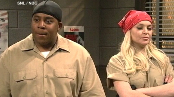 Lindsay Lohan, right, and Kenan Thompson are seen on an episode of Saturday Night Live, Saturday, March 3, 2012.