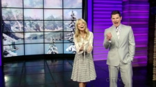 LIVE! host Kelly Ripa, left, makes an announcement along with Nick Lachey on the set of her talk show 'LIVE! with Kelly'.