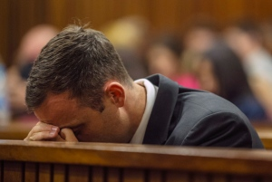 Oscar Pistorius sits in court for the last day of his sentencing hearing in Pretoria, Friday, Oct. 17, 2014. (AP / Mujahid Safodien