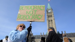 Protesters take part in a robocall protest on Parliament Hills in Ottawa on Monday, March 5, 2012. (Sean Kilpatrick /THE CANADIAN PRESS)