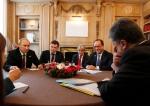 Ukrainian president Petro Poroshenko, right, talks with Russian President Vladimir Putin, left, as French President Francois Hollande watches during a meeting in Milan, Italy, Friday, Oct. 17, 2014. (AP / Luca Bruno)