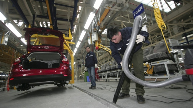 A Chinese worker cleans assembly line of the cars at a newly opened Changan Ford Mazda Automobile (CFMA) Chongqing Plant in Chongqing, China, Friday, Feb. 24, 2012. (AP Photo)