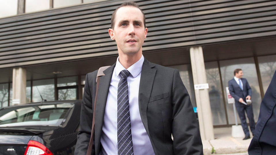 Former Conservative party staffer Michael Sona leaves court in Guelph, Ont. on Friday, Oct. 17, 2014. (Hannah Yoon / THE CANADIAN PRESS)