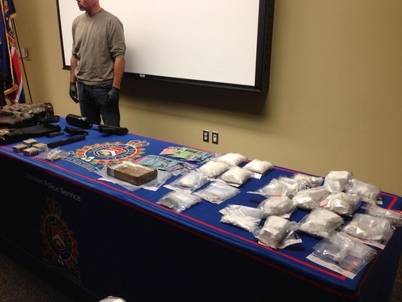 Weapons, cash and drugs seized after searches of two residence are on display in London, Ont. on Friday, Oct. 17, 2014. (Nick Paparella / CTV London)