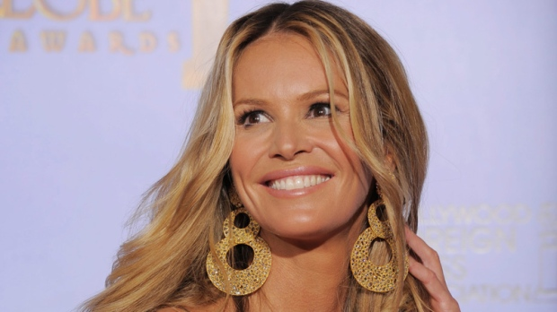 Elle Macpherson poses backstage during the 69th Annual Golden Globe Awards Sunday, Jan. 15, 2012, in Los Angeles. (AP Photo/Mark J. Terrill)