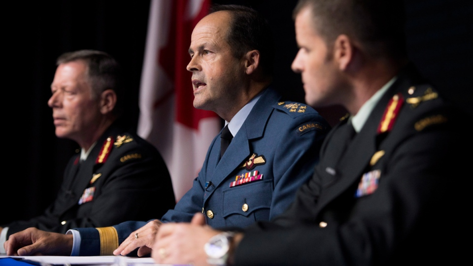 General Tom Lawson, Chief of the Defence Staff, centre, takes a question during a technical briefing on Operation IMPACT, Canada's support to the mission against the Islamic State of Iraq and the Levant (ISIL) as Lieutenant-General Jonathan Vance, Commander Canadian Joint Operations Command, left, and Brigadier-General Michael Rouleau, Commander Canadian Special Operations Forces Command, look on in Ottawa on Friday, Oct. 17, 2014. (Justin Tang / THE CANADIAN PRESS)