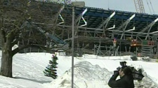 A cameraman films the Saputo Stadium, currently under construction next to the parking lot that collapsed (March 5, 2012)