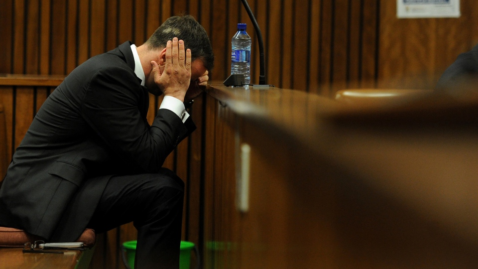 Oscar Pistorius sits in court for the last day of his sentencing hearing in Pretoria, Friday, Oct. 17, 2014. (AP / Werner Beukes, Pool)