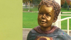 A statue of jeffrey Baldwin dressed as the superhero was unveiled in a Toronto park Saturday, Oct. 18, 2014.