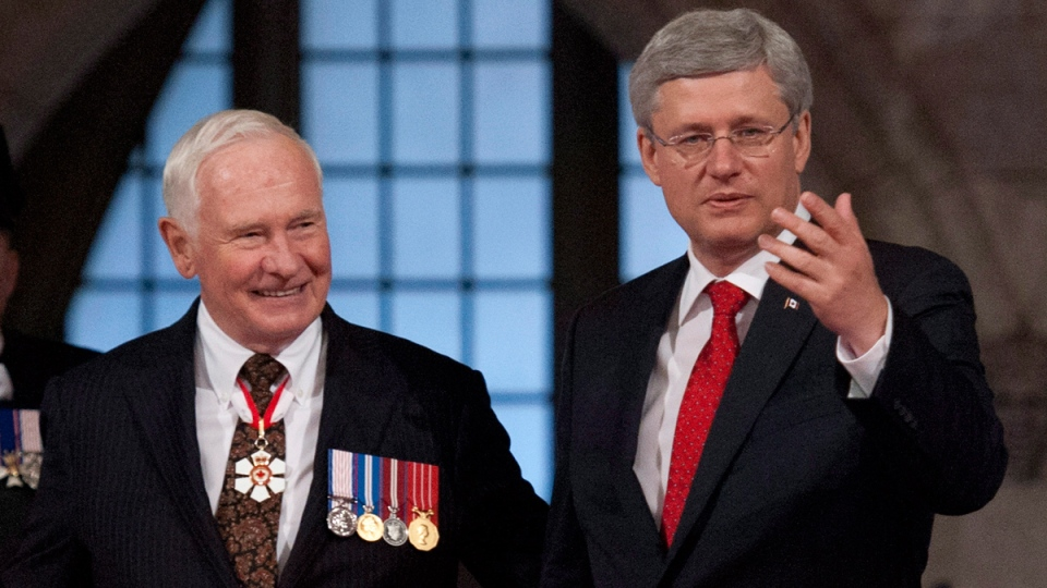 Canadian Prime Minister Stephen Harper welcomes Governor General David Johnston in the Senate Chamber on October 16, 2013. (THE CANADIAN PRESS / Justin Tang)
