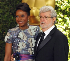 Filmmaker George Lucas and his wife, Chicago native Mellody Hobson, are seen on the red carpet at the 2013 Governors Awards in Los Angeles. (Invision / John Shearer)