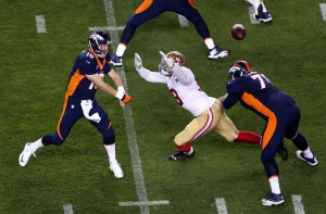 Denver Broncos quarterback Peyton Manning (18) throws his 509th career touchdown pass during the first half of an NFL football game against the San Francisco 49ers, Sunday, Oct. 19, 2014, in Denver. (AP Photo/David Zalubowski)