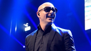 Pitbull performs in concert during the Q102 Jingle Ball at the Wells Fargo Center in Philadelphia, Dec. 4, 2013.  (Photo by Owen Sweeney / Invision)
