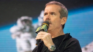 Retired astronaut Chris Hadfield speaks during 'We Day' in Toronto on Thursday, Oct. 2, 2014. (Hannah Yoon / THE CANADIAN PRESS)