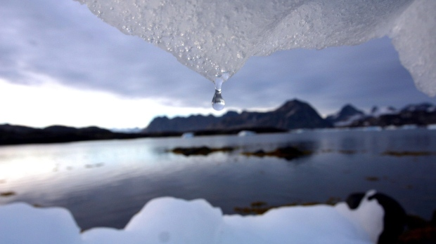 An iceberg melts in Kulusuk, Greenland near the arctic circle on Aug, 16, 2005. (AP / John McConnico)
