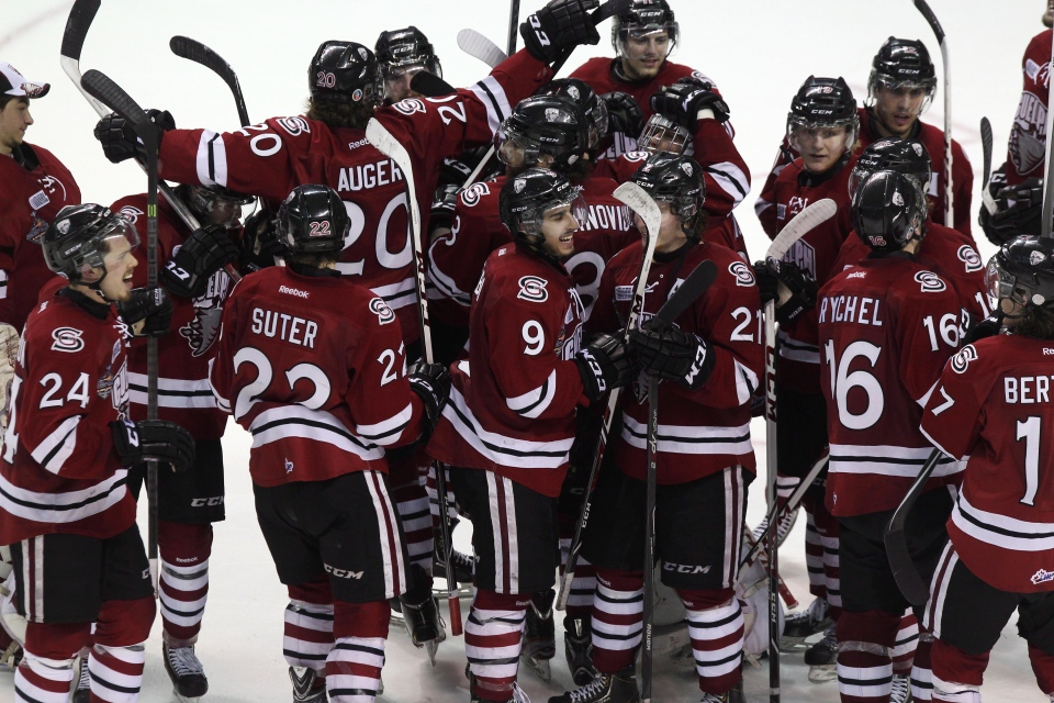 Guelph Storm players celebrate eliminating the London Knights in Game 6 of the Memorial Cup CHL hockey tournament, in London, Ont., Wednesday, May 21, 2014. (Dave Chidley / THE CANADIAN PRESS)