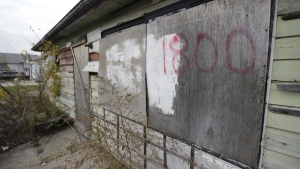 An abandoned home at 1800 E. 19th. Ave. in Gary, Ind., where police found the one of six women's bodies over the weekend, Monday, Oct. 20, 2014. (AP / M. Spencer Green)