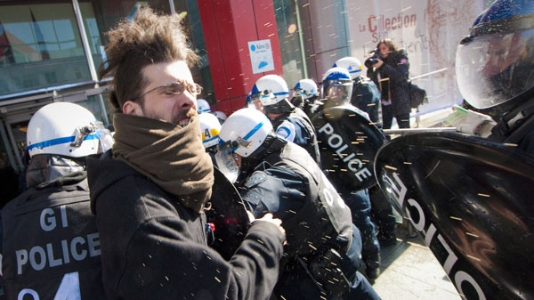Students protesting rising tuition costs square off against police in Montreal, Wednesday, March 7, 2012. THE CANADIAN PRESS/Montreal La Presse-Andre Pichette