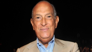 Designer Oscar de la Renta attends the Diane von Furstenberg Spring 2012 fashion show during Fashion Week in New York on September 11, 2011. (AP / Diane Bondareff, file)