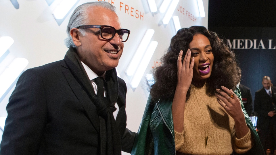 Solange Knowles, sister of Beyonce Knowles shares a joke with Joe Mimran of Joe Fresh at the Joe Fresh party at Toronto Fashion Week in Toronto on Monday, Oct. 20, 2014. (Chris Young / THE CANADIAN PRESS)