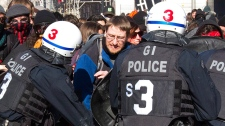 Police clash with students during a demostration in Montreal, Wednesday, March 7, 2012. (Marie-Esperance Cerda / THE CANADIAN PRESS)