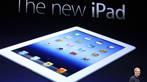 Apple CEO Tim Cook introduces the new iPad during an event in San Francisco, Wednesday, March 7, 2012. (AP / Jeff Chiu)